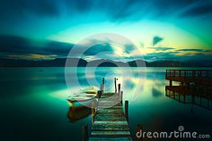 Wooden Pier Or Jetty And A Boat On A Lake Sunset. Versilia Tusca - Download From Over 39 Million High Quality Stock Photos, Images, Vectors. Sign up for FREE today. Image: 44955801