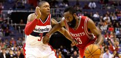 Harden, Rockets hold off Wizards rally as rain twice delays play