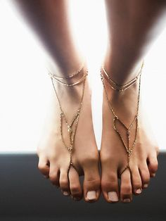Paradise Anklet Set | Set of two vintage-inspired anklets, each featuring double-banded snake chains that drape over the foot and toe loops for a completed look. Adjustable lobster clasp closure.