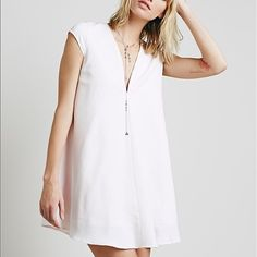 Free People Dusk Till Dawn Shift Dress Worn once - Free People Dusk Till Dawn Shift Dress. Solid white with a v neck top and cap sleeves. Has a silky under lining as well. Free People Dresses Mini