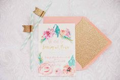 The bright colors on this invite complement the glitter accents perfectly.