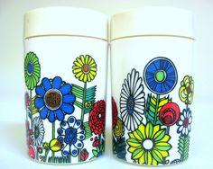 Mod Flower Power Salt & Pepper Shakers, 1970s, White Blue Green Red Yellow Plastic. $12.00, via Etsy.