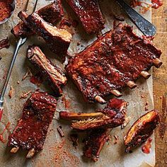 Sweet, Smoky Ribs | We have to admit, we cheated! Don't let their super smoky taste fool you--these babies were cooked in the oven! | #Recipes | SouthernLiving.com