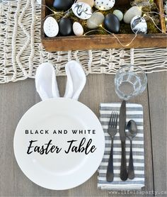 Black and White Easter Table: black and white Easter eggs, bunnies ears and tails, and forced Easter branches create the perfect modern Easter tablescape.