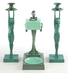 A PAIR OF FRANKART PATINATED METAL FIGURAL CANDLESTICKS AND SMOKER'S SET . Frankart, Inc., New York, New York, circa 1930.