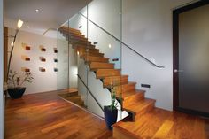 20 Glass Staircase Wall Designs With A Graceful Impact On The Overall Decor Emphasize the sculptural elegance of modern staircases with glass wallsstaircases with glass walls Staircase Glass Design, Glass Stairs, Interior Staircase, Floating Stairs, Modern Staircase, Stair Design, House Staircase, Wood Stairs, Glass Walls