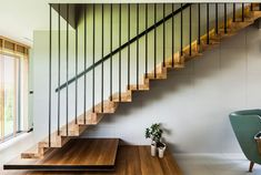 The minimalist staircase and its metal rod railing seem to be inspired by the house's facade design Staircase Design Modern, Modern Stairs, Modern Design, House Stairs, Facade House, Facade Design, House Design, Houses In Poland, Staircase Railings