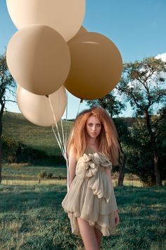 """Love the frizzed out hair. And the balloons! Very pretty photoshoot, check out the rest of the pictures  """"Hometown Romance series focuses on two girls, Henriette and Seraphina, dressed in period costumes with alluring colors, walking in fields near a farm, meeting sheeps and chickens. Back to basics of life."""""""