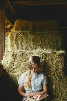 A quiet place to read. This young rider has found a perfect hideaway in the hayloft to get lost in a great adventure.