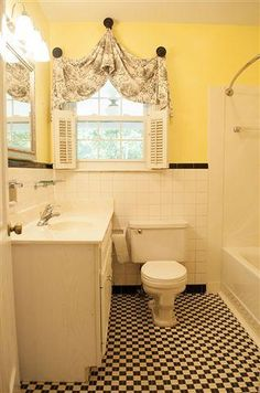 The window treatment makes the bath. I like the yellow walls against the black & white fabric.