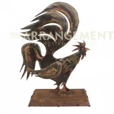 "Weathered Rooster Sculpture  Sheets of hand worn, variegated color metal are the make-up of this crowing rooster accent piece. At 27"" tall, this piece is the perfect addition to your country western home or rustic interior."