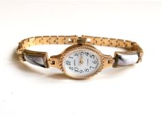 Gold Soviry Retro watch works great. It is very miniature and elegant gold womens watch with beautiful original enameled bracelet. Womens soviet watch