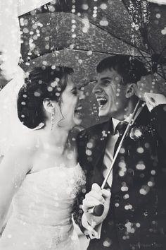 A little bit of rain doesn't have to put a damper on your big day! Seize the moment by getting great rain shots like this!