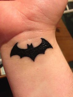 Batman wrist tattoo... I would never get this but thought it was neat.