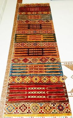 The production of these Kazak carpets is mostly woven by Afghani weavers in Afghanistan. Our Kazak carpet selection is based on traditional Caucasian designs and made of supreme quality wool yarns, much of which have been dyed using natural vegetable dyes thus adding to their beautiful and shiny appearance. These semi-antique carpets are very decorative and suitable to all kinds of furniture styles.
