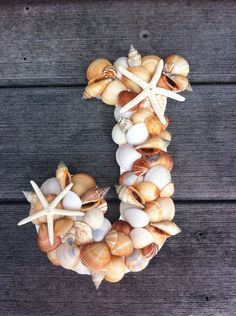 Sea shell letter, for the back of our chairs? Maybe even mr.  mrs. ? Hmmm