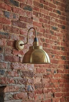 For a distinctive look, consider industrial luxe wall lighting to create a warm glow in your master bathroom. We love this style by Industville
