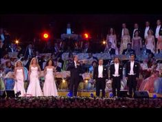 Not IL Divo but beautiful just the same.  I think this is the first time I have ever seen women in an orchestra dressed in anything but black.  This is just beautiful.  André Rieu : You'll Never Walk Alone