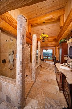 Stone, tile, and timbers; interesting wood ceiling. Round log post-and-beam home by Pioneer Log Homes of British Columbia