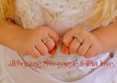 I like the idea of having your little girl wearing your wedding ring while in your dress :)