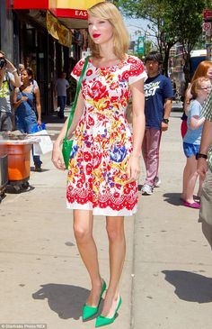 Shine bright: Taylor Swift wore a colourful floral frock with green heels while out in New York on Friday