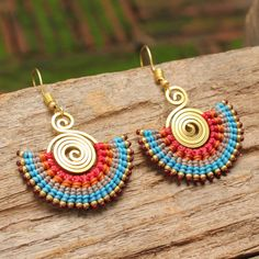 Woven cotton and shaped brass earrings in blue by cafeandshiraz, $45.00