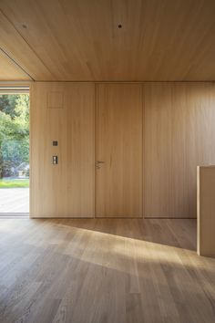 Image 12 of 28 from gallery of L House / Juri Troy Architects. Photograph by Juri Troy Troy, Vienna Woods, Hidden Pantry, Timber Panelling, My House, Floor Plans, House Design, Flooring, Doors