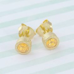 Gold And Citrine Birthstone Stud Earrings - A stunningly simple and elegant pair of stud earrings featuring a single semi precious citrine stone in a naturally textured gold setting. #Embersjewellery #Jewellery #November #Birthstone #Topaz #Citrine