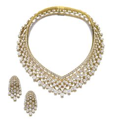 ATTRACTIVE DIAMOND DEMI-PARURE, 'MALINES', VAN CLEEF & ARPELS, CIRCA 1985. Comprising: a necklace of lattice design, set with pear-shaped and brilliant-cut diamonds, inner circumference approximately 370mm; the ear clips similarly set, all pieces signed Van Cleef & Arpels and numbered, French assay and maker's marks.