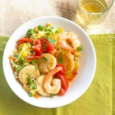 Speedy Paella If you love paella, try this irresistible recipe twist. Simply toss together scallops, plum tomatoes, and shrimp with rice, peas, corn, and carrots.