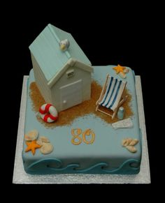 Beach hut cake complete with deckchair, life buoy, seagull, flask, newspaper and shells!