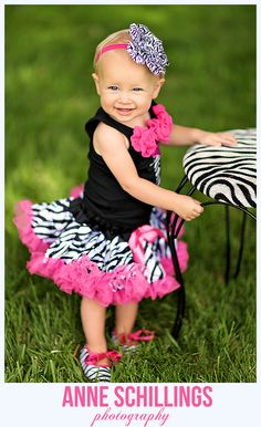 Anne Schillings Photography Child Portrait Photo One year old high heels cake smash streamers flowers crepe paper cupcake zebra pink hot black white stool shoes tutu pettiskirt bow fuschia pearls pink romper hair bow outdoor birthday sonoma county windsor santa rosa healdsburg marin napa photographer baby girl  tutu top & hair bow by Tutu A Gogo  https://www.facebook.com/anneschillingsphotography