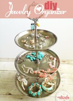 Use a thrifted, teared tray to organize your jewelry.  Why didn't I think of this? Entirely Eventful Day: Organize Pretty: DIY Jewelry Organizer entirelyeventfulday.com #organize