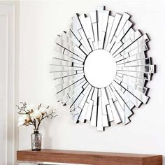 Gift this glass-and-wood sunburst mirror to an aspiring interior decorator on your list. via @overstock