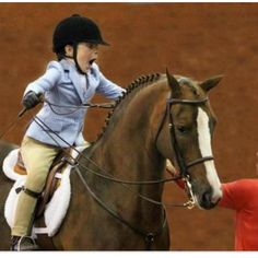 This young equestrian is excited about something!  First Place maybe??