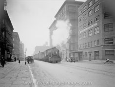1929, Freight trains used to run down 10th and 11th Ave. before the High Line was built.