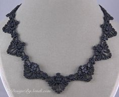 You can find this pattern here: http://store.sandradhalpenny.com/blue-cube-necklace-pattern-p193.php