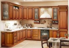 Lovely kitchen cabinets with partial see-through glass front cabinet doors.