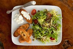 This lentil recipe served with goat cheese crostini combines French lentils with tomatoes, fennel, and frisée.