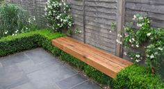 Surround a floating bench with a box hedge.