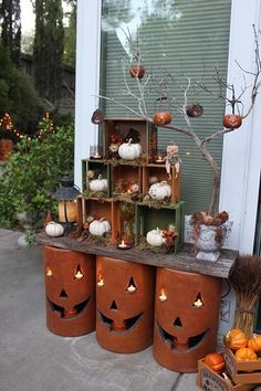 Fall Decorating Idea: Nested crates and pottery pumpkins on two weathered boards