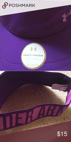 Under armour sun visor Perfect visor play golf, beach trip, working in the yard!  This is a comfortable visor can be dressed down or up depending on your mood!  Pretty purple with pink Under Armour Tops