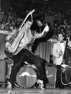"""Dancing is good exercise. My dad used to dance like Elvis and play his guitar in the livingroom. """"You ain't nothin' but a hound dog"""""""