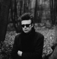 Stuart Sutcliffe photographed by Astrid Kirchherr, in the woods near the river Elbe, 1960.
