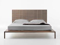 Twin walnut bed by M