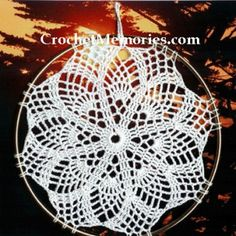 Pineapple Suncatcher Designed by: Cylinda Mathews Tested by Vicki Mashburn Materials: Sm ball 100% cotton thread, size 10 Steel crochet hook size 8 USA (1.50 mm) 7″ metal ring Finished Size: 7″ dia Gauge: 2 rows = 1/2″ Skill Level: Intermediate Model... #pineapplepatterns #suncatcherpatterns