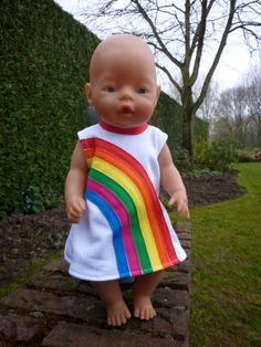 Baby Born doll in rainbow dress