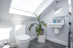 To free up space and create the illusion of a larger room consider the use of free-standing features as a design idea, like this loft conversion bathroom built in South East London thanks to Simply Loft. Loft Conversion Tips, Loft Bathroom, East London, Illusion, Larger, Space, Create, Design, Floor Space