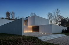 CUBYC Architects have designed the DM Residence in Keerbergen, Belgium.