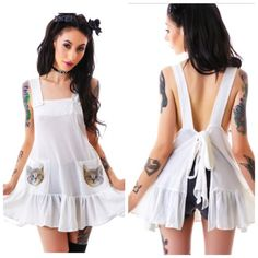 """1HR⚡️Wildfox-Cat Pockets Little Apron Tank, S It really hurts to sell this one...  This little apron tank is ADORABLE! Description in picture 4. This isn't super white, but almost a creamy white. 2 adorable cat pockets, and you can tie back to your comfort level. It is approx 28""""L, and it's adjustable, so it definitely fits a medium.  I thought I'd wear this a bunch, but I haven't worn it yet, so I'm going to sell before I get too attached. I don't think this was ever worn/washed.  Looks…"""